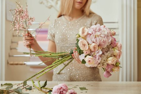 Photo for Selective focus of croppedl view of florist making bouquet of roses and peonies at workspace - Royalty Free Image
