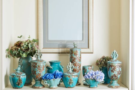 Photo for Picture frame, bouquets and turquoise set on shelf - Royalty Free Image