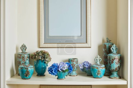 Photo pour Picture frame and turquoise set with flowers on surface with copy space - image libre de droit