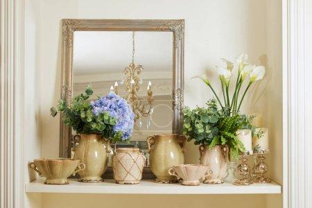 Photo pour Mirror, vintage set with blue and white flowers on shelf - image libre de droit