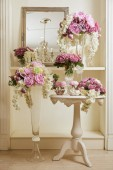 Interior of room with mirror and flowers in glass vases