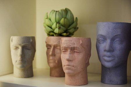 Photo pour Selective focus of figures with green plant on surface - image libre de droit