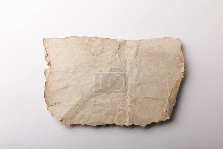 Photo for Top view of aged paper sheet lying on white background - Royalty Free Image