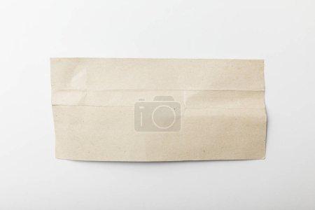 Foto de Vista superior del papel de textura en blanco aislado en blanco - Imagen libre de derechos