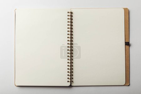 Photo for Top view of opened notebook with blank pages on white background - Royalty Free Image