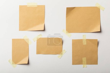 Foto de Blank brown papers with sticky tape on white background - Imagen libre de derechos