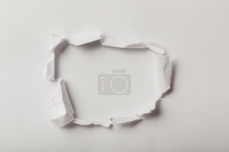 Photo for Top view of ripped sheets of paper on white background - Royalty Free Image