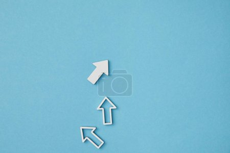 Photo for Top view of white vertical pointers on blue background - Royalty Free Image