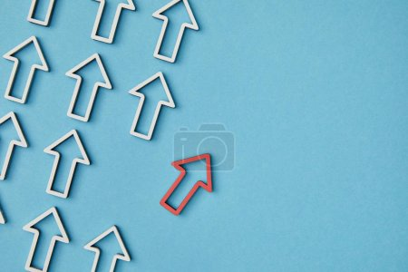 Photo for Top view of diagonal rows with white arrows with red pointer on blue background - Royalty Free Image