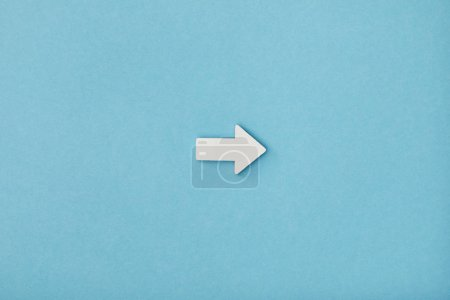 Photo for Top view of white horizontal pointer on blue background - Royalty Free Image