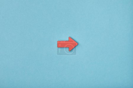 Photo for Top view of red horizontal pointer on blue background - Royalty Free Image