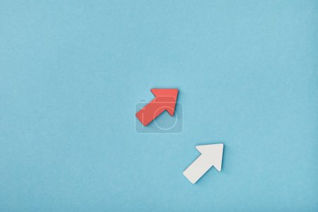 top view of red and white diagonal arrows on blue background