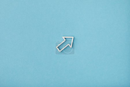 Photo for Top view of white diagonal frame pointer on blue background - Royalty Free Image