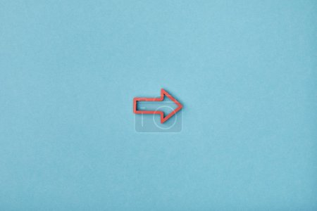 Photo for Top view of red horizontal frame pointer on blue background - Royalty Free Image
