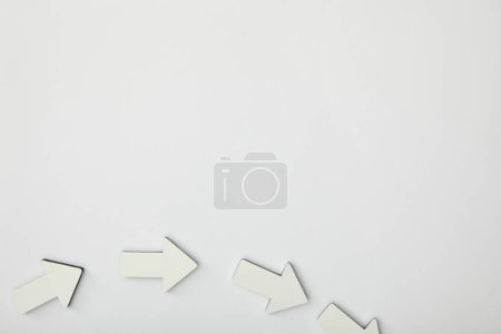 Photo for Top view of white arrows on grey background - Royalty Free Image