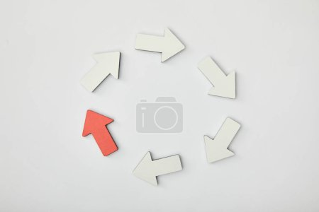 Photo for Top view of white arrows and red pointer in circle on grey background - Royalty Free Image