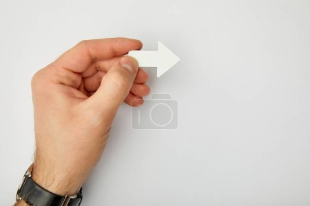Photo for Cropped view of man holding white pointer on grey background - Royalty Free Image