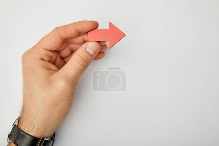 Photo for Cropped view of man holding red pointer on grey background - Royalty Free Image