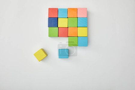 top view of multicolored blocks on grey background