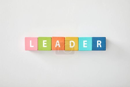 Photo for Top view of leader lettering made of multicolored blocks on grey background - Royalty Free Image
