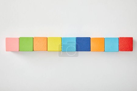 top view of set of colorful cubes on grey background