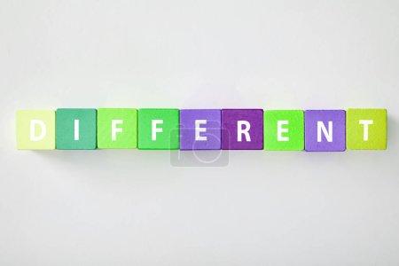 Photo pour Vue de dessus des lettres différentes faites des cubes multicolores sur fond gris - image libre de droit