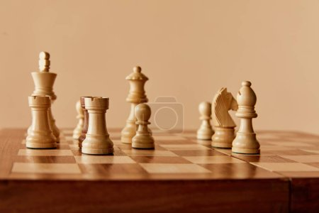 Photo for Chess on chess board and beige background - Royalty Free Image