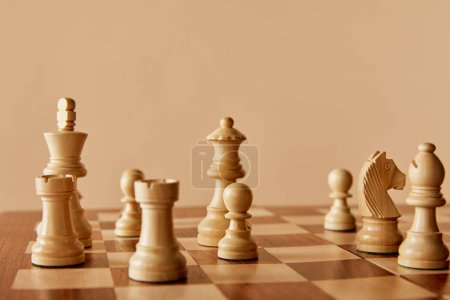 Photo for Wooden chess on chess board and beige background - Royalty Free Image