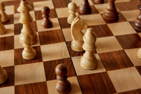 Photo for Chess pieces on wooden brown chess board - Royalty Free Image