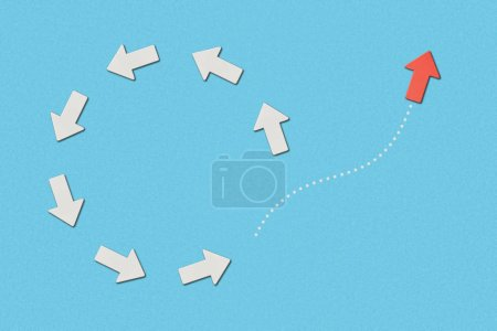 Photo for Top view of red pointer and white arrows in circle on blue marked background - Royalty Free Image