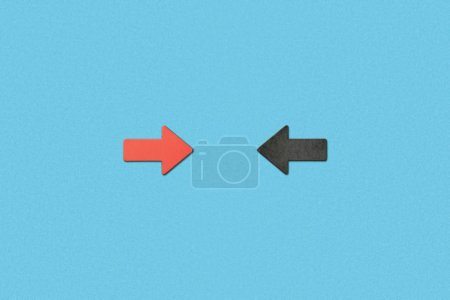 Photo for Top view of opposite horizontal red and black arrows on blue background - Royalty Free Image
