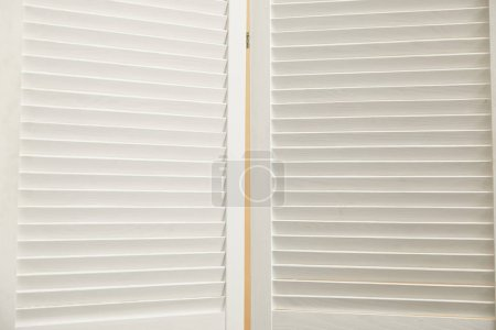 close up of  white wooden room divider with copy space