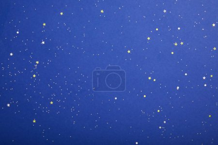 top view of violet starry background with copy space, earth day concept