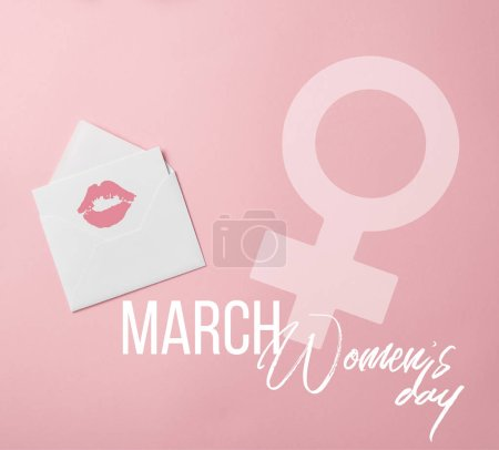top view of greeting card with lips mark in white envelope with womens day and female sign illustration