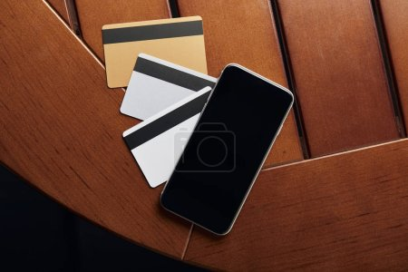 Photo for Top view of credit cards and smartphone with copy space - Royalty Free Image