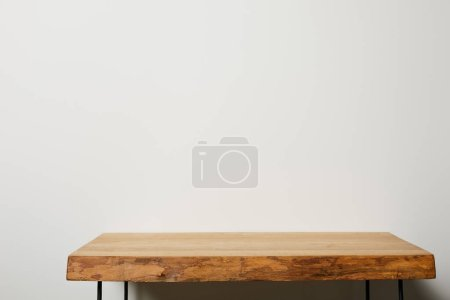 Photo for Textured wooden brown table at home - Royalty Free Image