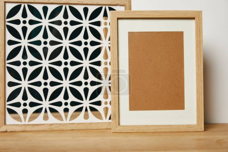 Photo for Blank frame near decorative ornate frame on table - Royalty Free Image