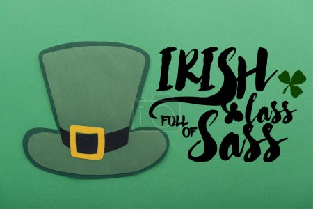 Photo for Paper hat near irish lass full of sass lettering on green background - Royalty Free Image