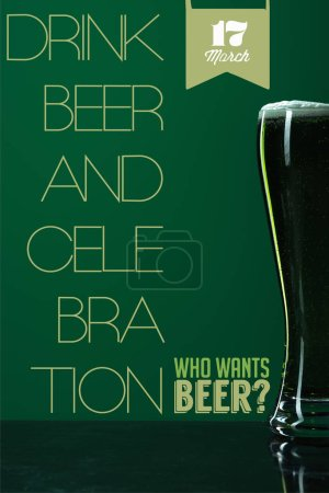 Photo for Glass of beer with foam near drink beer and celebration lettering on green background - Royalty Free Image