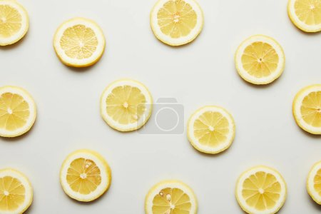 Photo for Top view of juicy lemon slices on grey background - Royalty Free Image