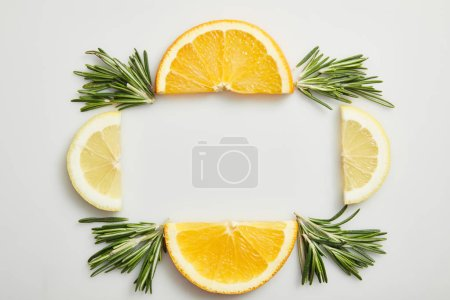 Photo for Flay lay with orange and lemon slices on grey background - Royalty Free Image