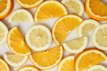 Photo for Top view of orange and lemon slices on white background - Royalty Free Image