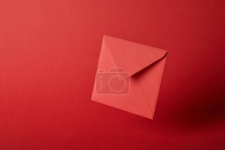 bright, colorful and empty envelope on red background with copy space