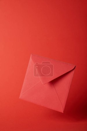 Photo for Bright, colorful and empty envelope on red background with copy space - Royalty Free Image