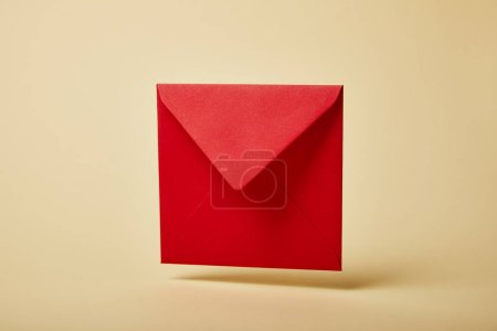 Photo for Red and bright envelope on colorful and yellow background with copy space - Royalty Free Image