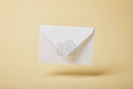 Photo for White and empty envelope on yellow background with copy space - Royalty Free Image