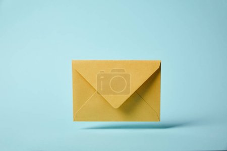 Photo for Yellow and colorful envelope on blue background with copy space - Royalty Free Image