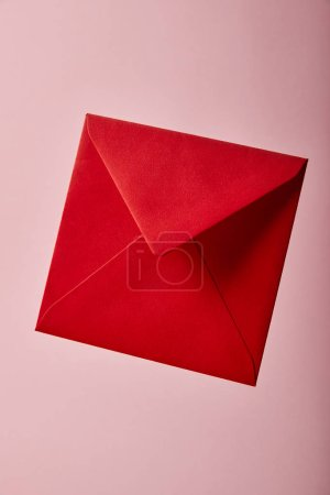 Photo for Red and bright envelope on pink background with copy space - Royalty Free Image