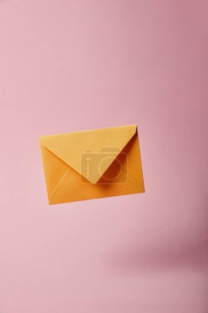 Photo for Yellow and bright envelope on pink background with copy space - Royalty Free Image