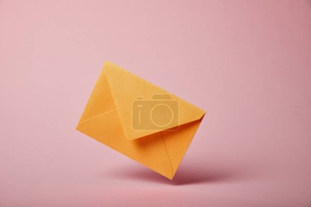 Photo for Yellow and colorful envelope on pink background with copy space - Royalty Free Image